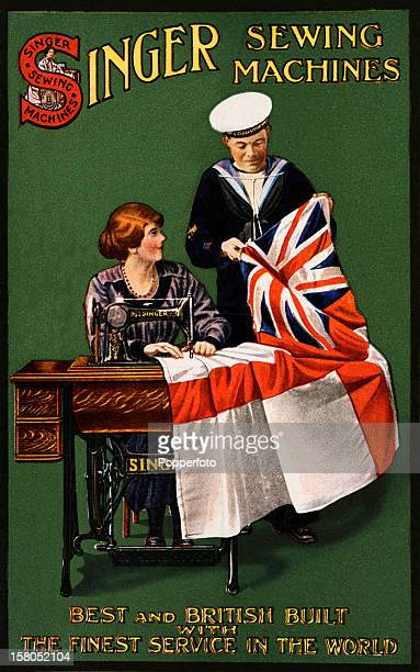 A vintage colour postcard advertising Singer sewing machines featuring a seamstress at her machine sewing flags inspected by a Naval cadet circa 1910