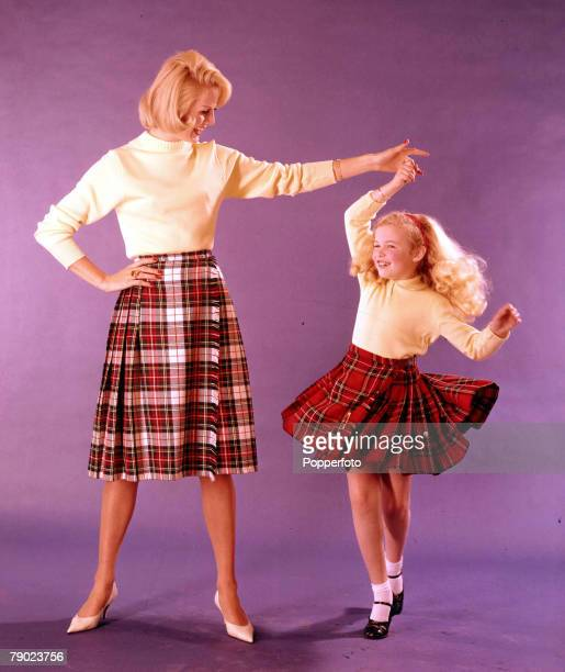 1961 Vintage colour transparency People A studio portrait of a Mother and daughter wearing tartan skirts with Young girl dancing