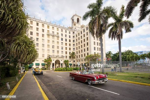 vintage convertible car in front of hotel nacional in havana, cuba - havana stock pictures, royalty-free photos & images