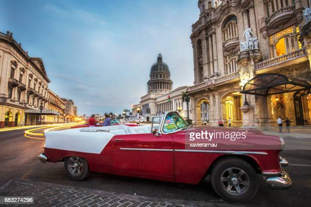 vintage convertible taxi on street during sunset - havana stock pictures, royalty-free photos & images