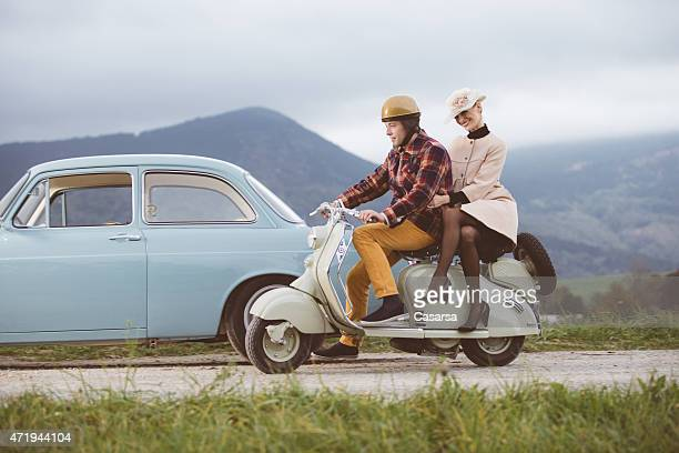 Vintage couple on scooter