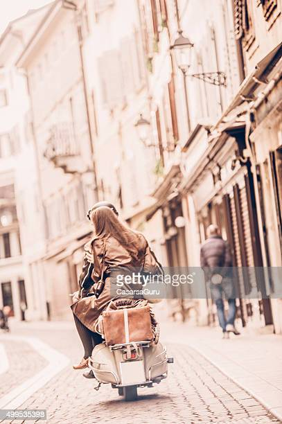 vintage couple with scooter in italy - gorizia stock pictures, royalty-free photos & images