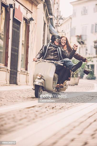 Vintage Couple with Scooter in Italy