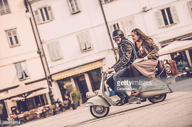 Vintage Couple with Vespa Scooter in Italy