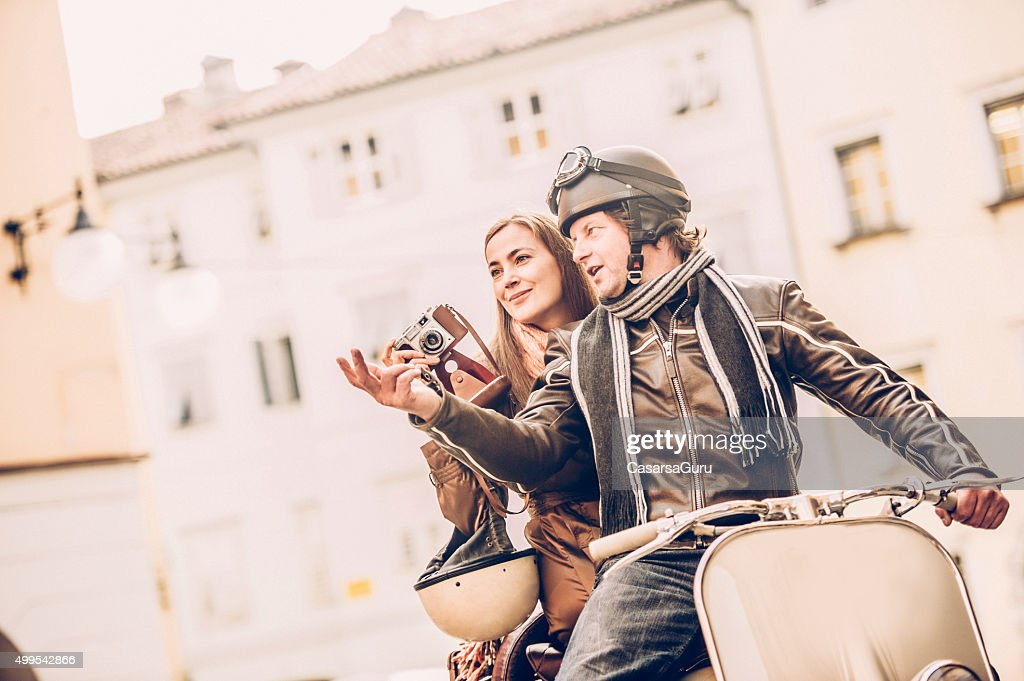 Vintage Couple With Vespa Scooter In Italy High-Res Stock ...