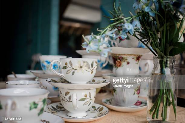 vintage cups and saucers for wedding decoration - porcelain stock pictures, royalty-free photos & images