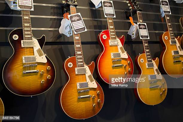 Vintage custom Gibson Les Paul guitars in various colours at a guitar shop in London United Kingdom