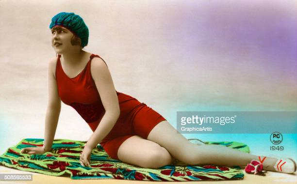 Vintage deco photograph of a French beauty posing in a bathing suit c 1920 Handcolored silver print