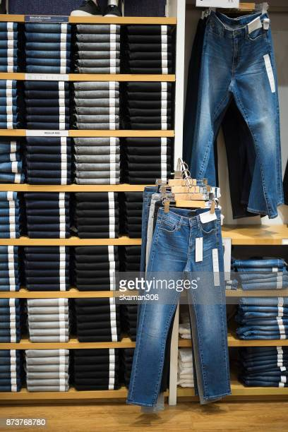 Vintage Denim jeans stack on shelves