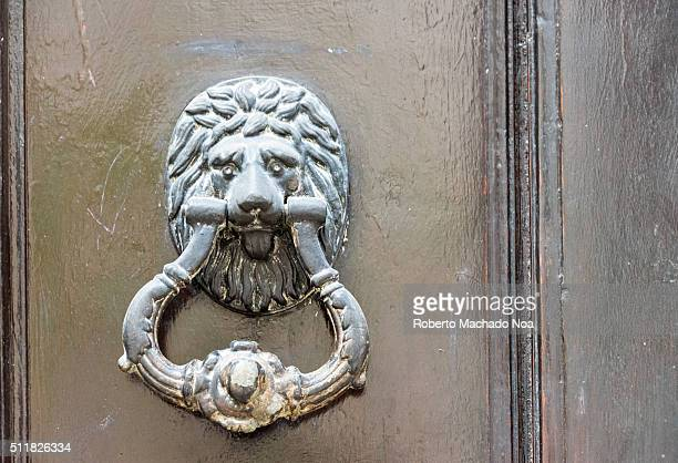 Vintage door metal made handle lion shaped with historical architectural feature showing Cubans artwork and tradition