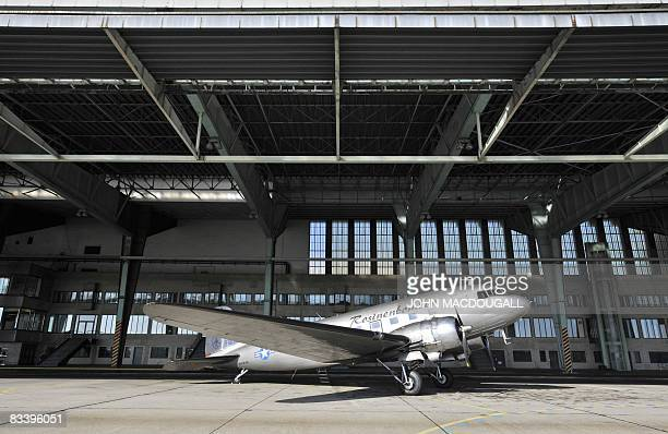 """Vintage Douglas DC-3 aircraft, known as a """"Rosinenbomber"""" waits to take on passengers for a flight over Berlin at Tempelhof airport, on October 23,..."""
