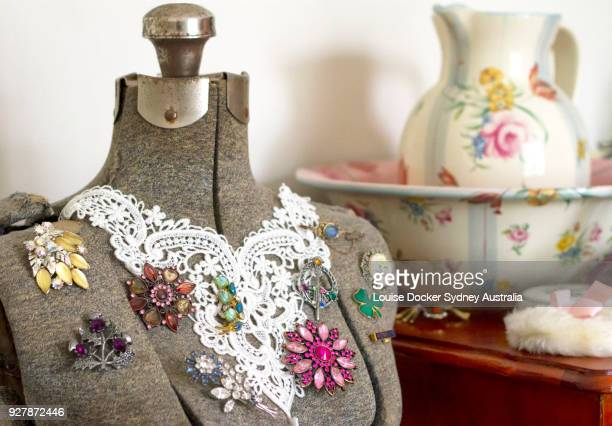 vintage dressmakers dummy with old brooches - brooch stock pictures, royalty-free photos & images