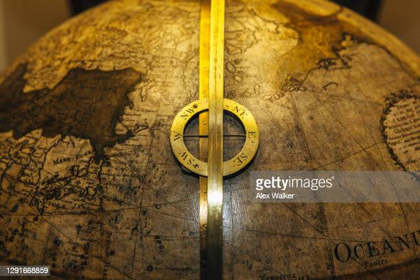 vintage earth globe with brass compass rose - national border stock pictures, royalty-free photos & images