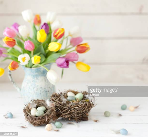 vintage easter tulips and easter eggs on an old white wood background - easter flowers stock pictures, royalty-free photos & images