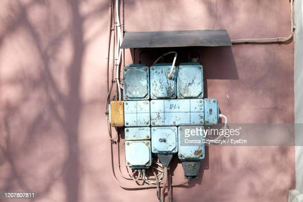 vintage electricity circuit box, blue on a pink wall, old engineering technology. high voltage - pink hub stock pictures, royalty-free photos & images