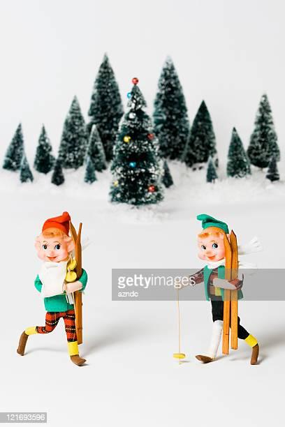 Vintage elf figurines on with snow Christmas scenario