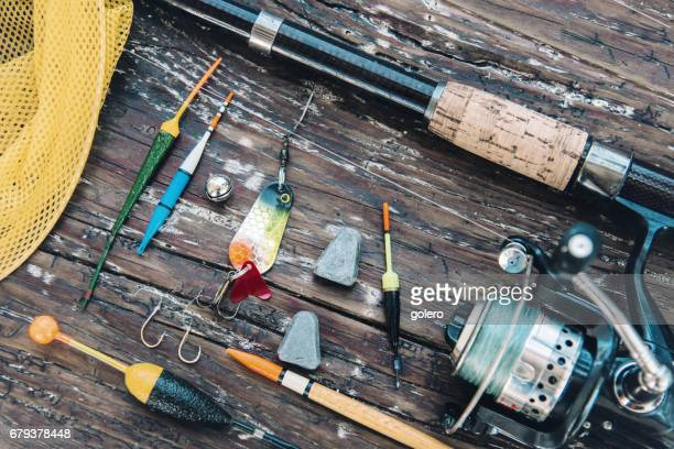 vintage fishing equipment on rustic wooden plank