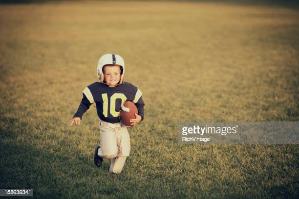 vintage footballer - rush american football stock pictures, royalty-free photos & images