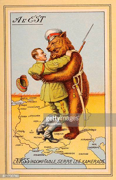 A vintage French propaganda postcard illustration featuring Nazi Germany's Adolf Hitler in the clutches of the Russian bear standing on a map of the...