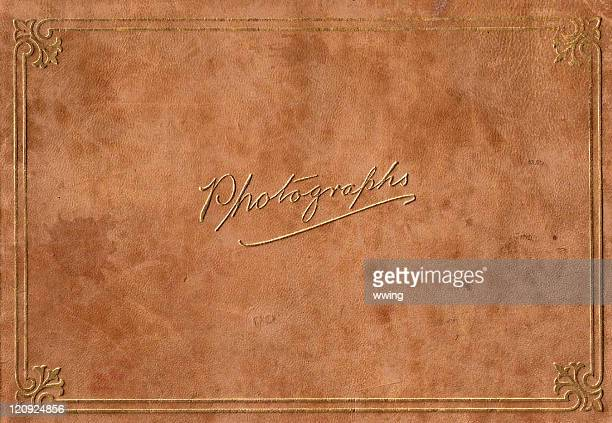 vintage full size leeather embossed in gold photograph album - photo album stock photos and pictures
