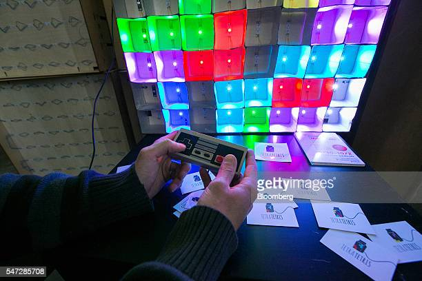 A vintage games console controller triggers lights in a Tetra Pak milk and juice carton light installation at the Tech Open Air conference in Berlin...