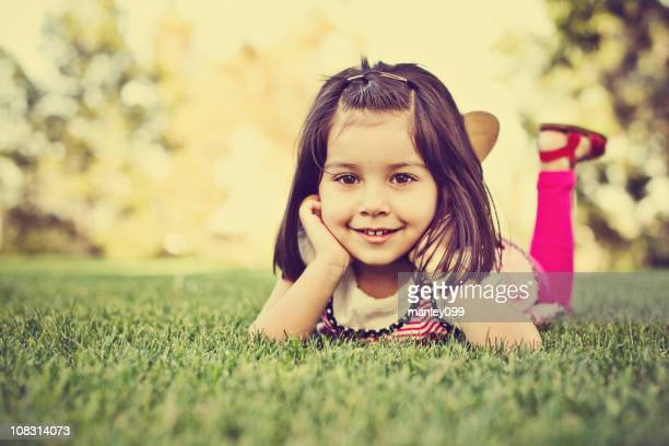 vintage girl laying on grass