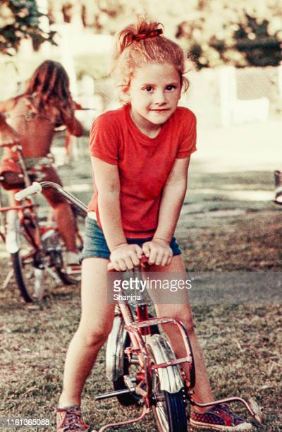 vintage girl on a bike - archival stock pictures, royalty-free photos & images
