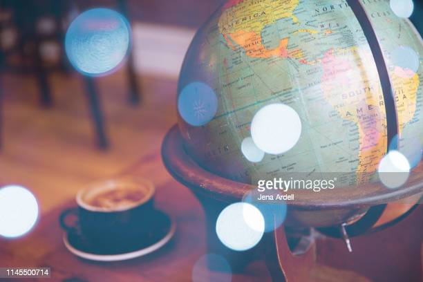vintage globe, cozy coffee shop, no people, travel, adventure, latte, dreamy - latin america stock pictures, royalty-free photos & images