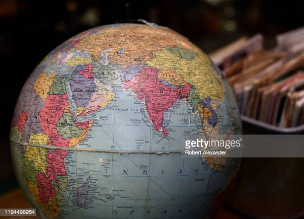 A vintage globe of the world for sale in an antique shop showing the Indian Ocean and surrounding countries including India the eastern coast of...