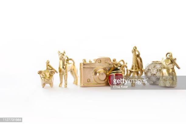 vintage gold charm lineup - charm bracelet stock pictures, royalty-free photos & images