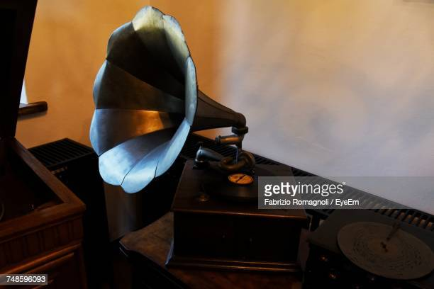 Vintage Gramophone On Table Against Wall