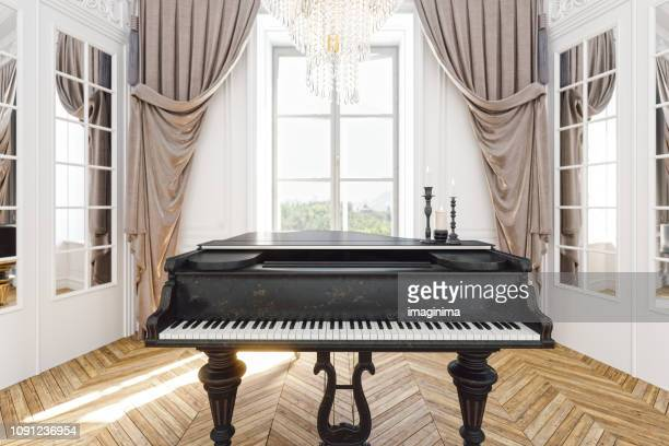 vintage grand piano in the baroque style room - grand piano stock photos and pictures