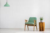 Vintage green armchair in room