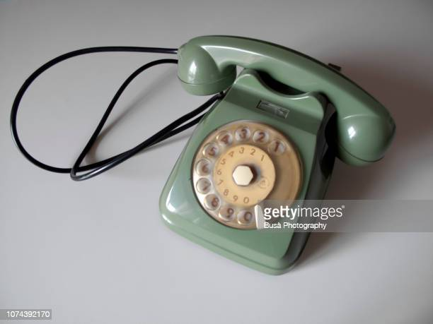vintage green telephone on a white background - khaki green stock pictures, royalty-free photos & images