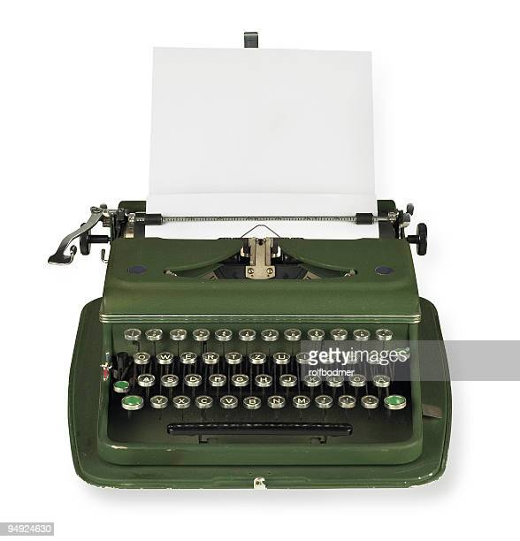 Vintage, green typewriter with paper on white background
