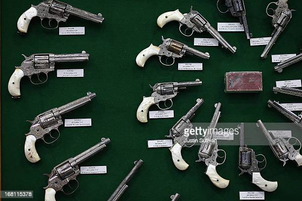 Vintage handguns are displayed during the 2013 NRA Annual Meeting and Exhibits at the George R Brown Convention Center on May 5 2013 in Houston Texas...