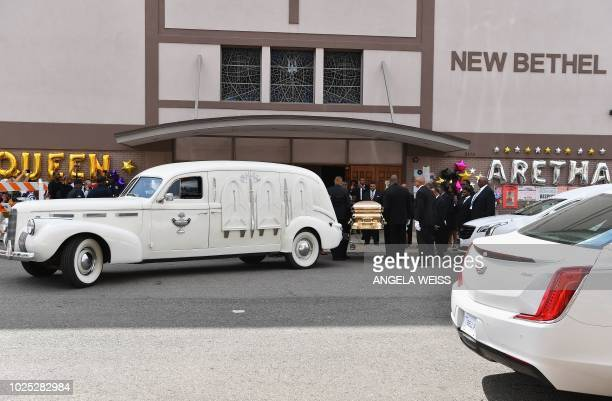A vintage hearse and golden casket carrying the remains of Aretha Franklin arrive for her viewing at the New Bethel Baptist Church on August 30 2018...
