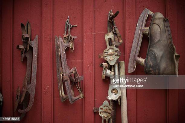Vintage ice skates hanging from wall