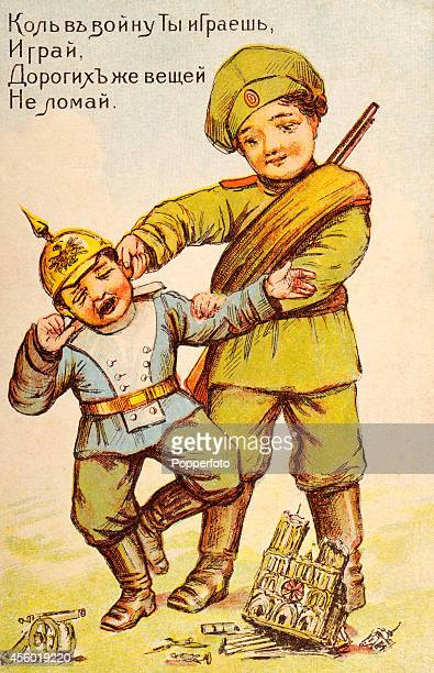 A vintage illustration featuring antiGerman propaganda illustrated on a Russian postcard with a young Russian soldier pulling the ears of a small boy...