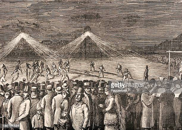 A vintage illustration featuring crowds watching a football match between the Wanderers and the Clapham Rovers under electric lights at the...