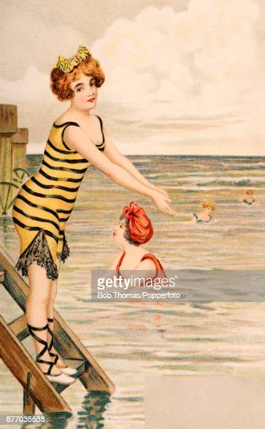 A vintage illustration featuring several bathing beauties one about to jump from a bathing hut at the seaside circa 1900