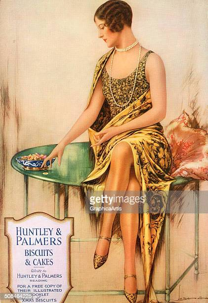 Vintage illustration for Huntley Palmers Biscuits Cakes with a lovely flapper with long pearls and bobbed hair sitting on a table c 1925 Screen print