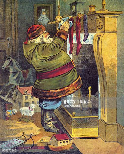 Vintage illustration from the poem 'The Night Before Christmas or a Visit from St Nicholas' of Santa tacking stockings of gifts on the mantle on...