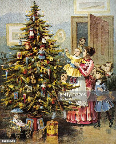 Vintage illustration from the poem 'The Night Before Christmas or a Visit from St Nicholas' of a family with their tree and gifts on Christmas...