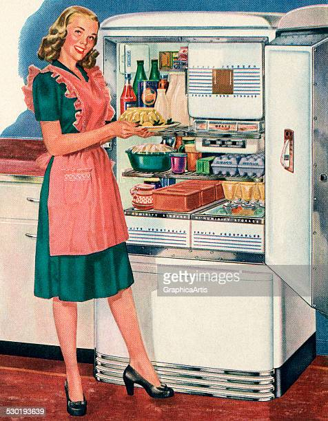 Vintage illustration of a happy homemaker in a pink apron showing off foodstuffs in front of her new refrigerator 1946