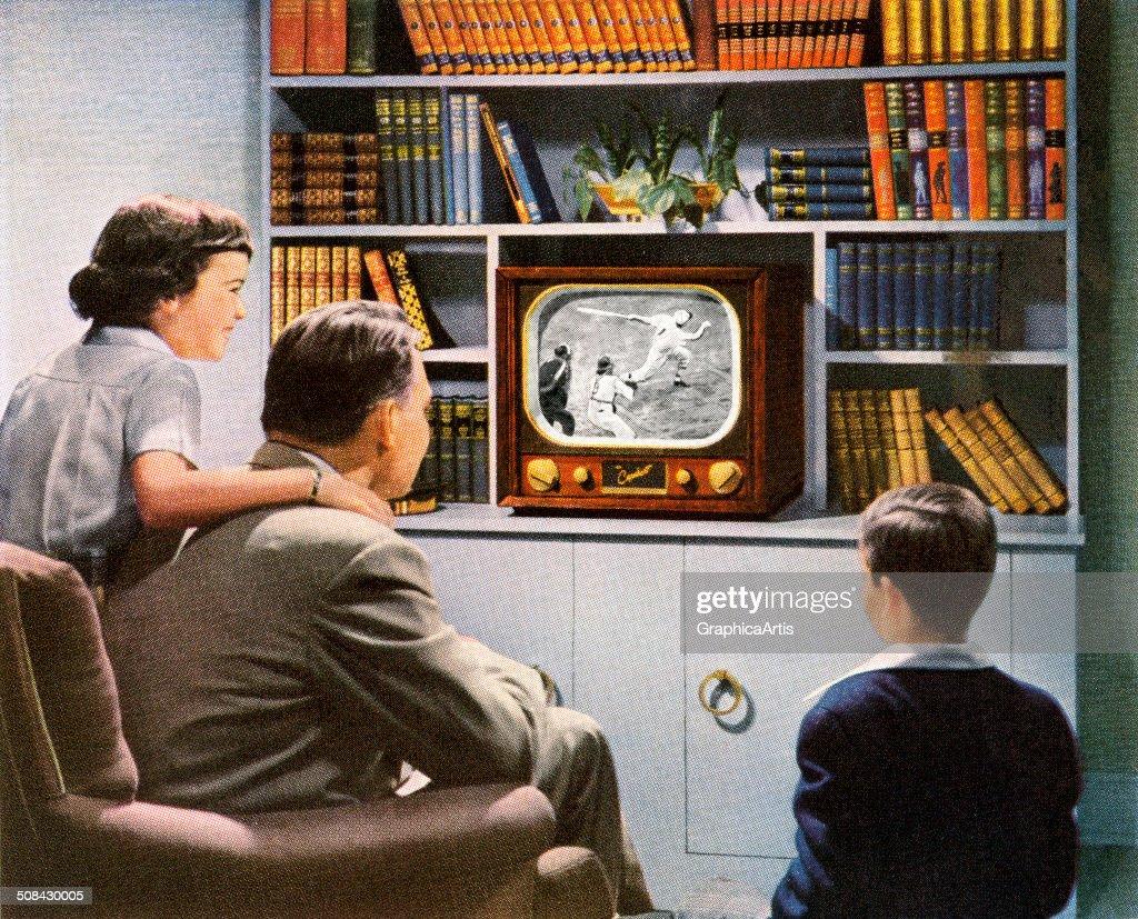 Family Watching Baseball On Tv : News Photo