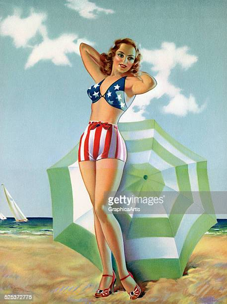 Vintage illustration of a sexy patriotic model wearing an American flag swimsuit posing on the beach lithograph 1940