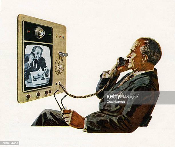 Vintage illustration of businessman talking on a futuristic telephone with video display 1956 Screen print