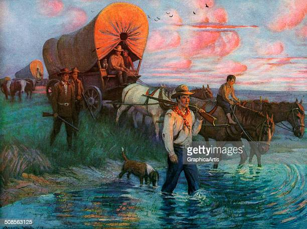 Vintage illustration of pioneers crossing the American Plains in covered wagons print 20th century