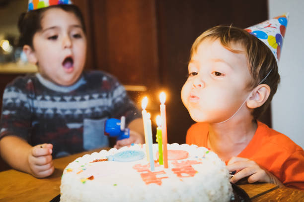 vintage image from the seventies, children blowing birthday cake candles - best friend birthday cake stock pictures, royalty-free photos & images
